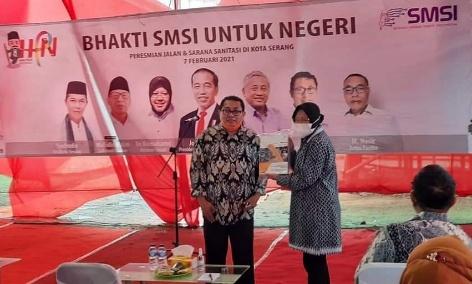 Menteri Sosial RI Tri Bersama Ketua Umum Serikat Media Siber Indonesia (SMSI) Firdaus.